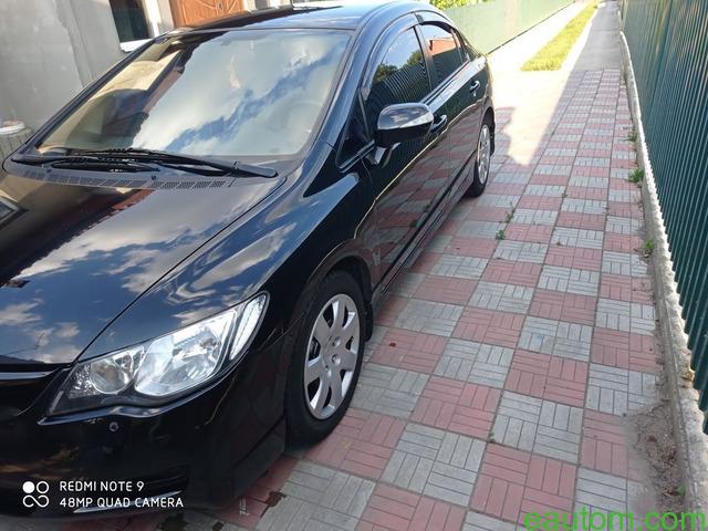 Civic 4d 1.8at - 7